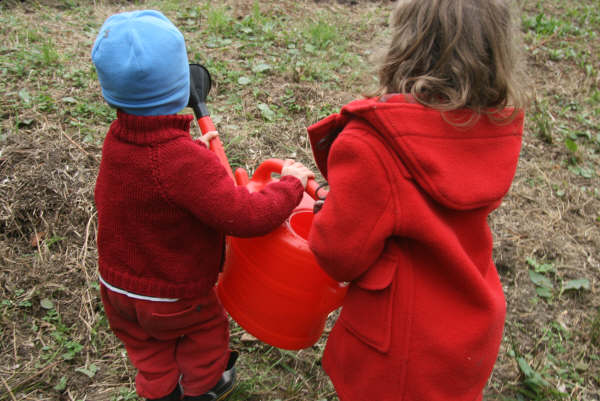 2-kids-and-a-watering-bucket